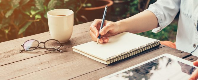 Young Business Woman Hand With Pencil Writing On Notebook. Woman