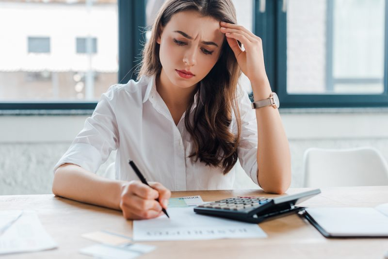 Frustrated small business owner bookkeeping